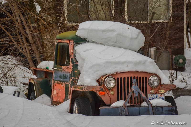 Old truck buried in snow photo