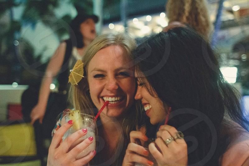 2 woman smiling photo