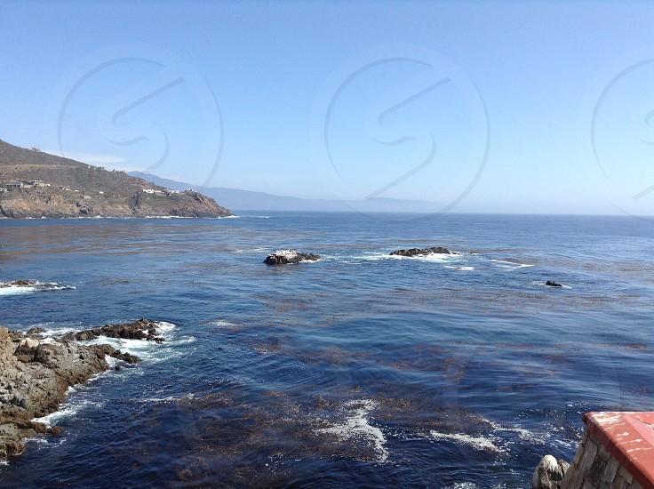 Mexico ocean rocks coastline mountains blue skies  photo