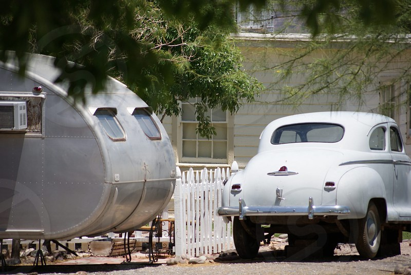 Vintage Plymouth and travel trailer photo