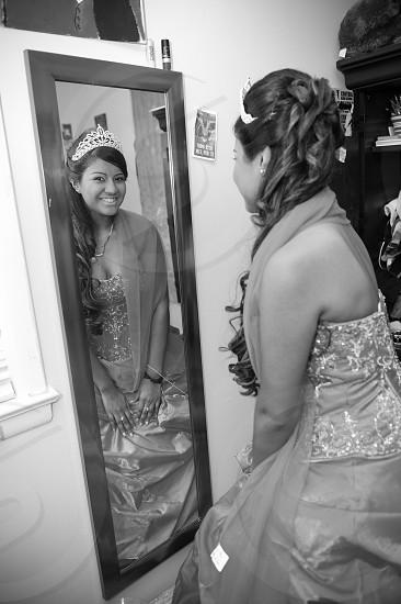 woman wearing dress looking at mirror photo