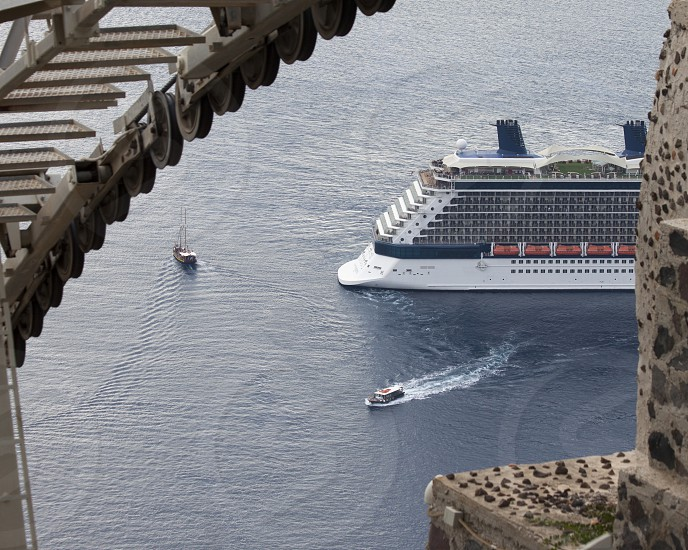 A cruise ship tether bringing passengers to shore in Santorini Greece photo
