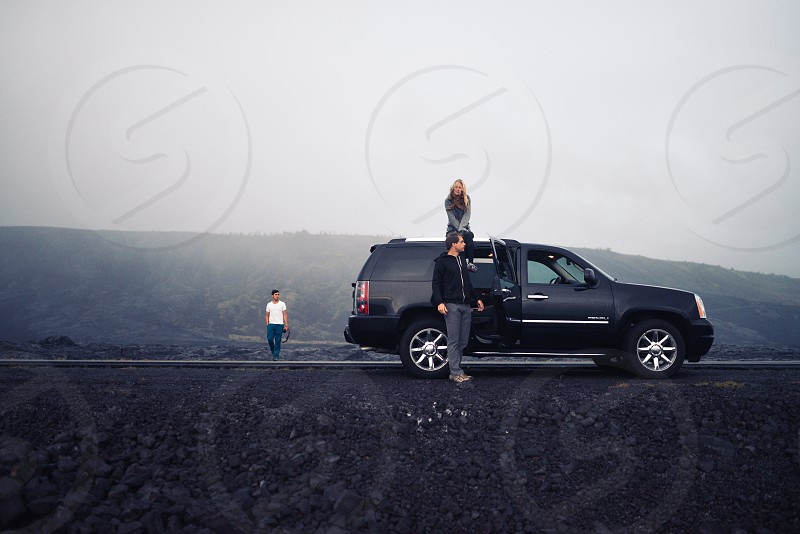 road trip young adults suv lava photo