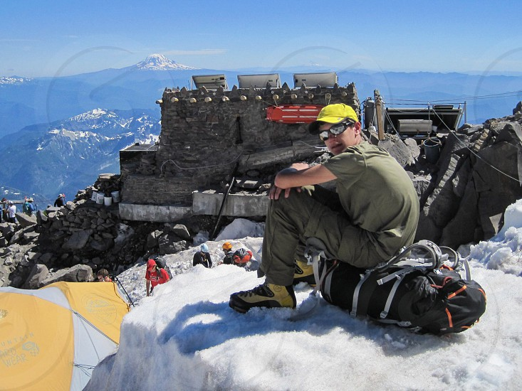 Mountain snow hiking glacier climb summit young man outdoor Rainier Washington gear photo