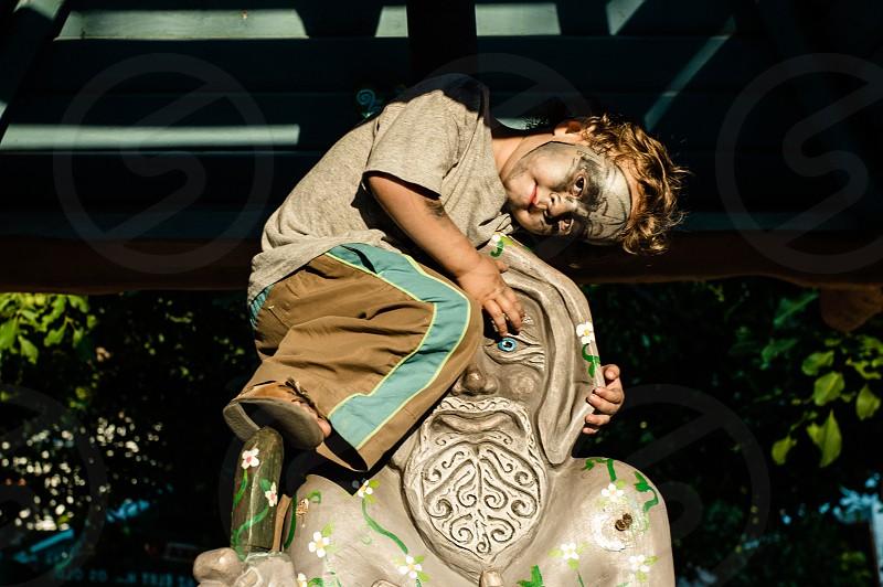 child statue face paint party climb gazebo stare playground photo