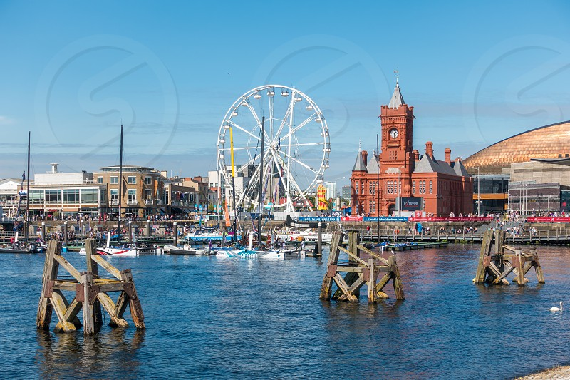 CARDIFF/UK - AUGUST 27 : Ferris Wheel and Pierhead Building in Cardiff on August 27 2017. Unidentified people photo