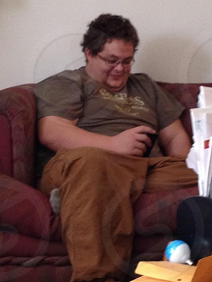 man in grey t-shirt sitting photo