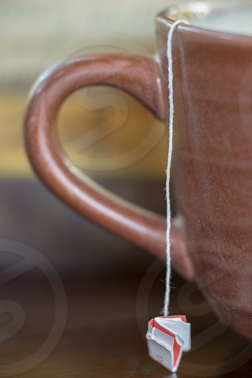 tea cup tea tea bag string mug cup photo