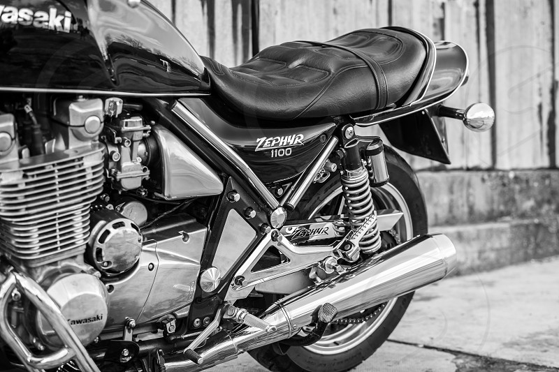 Subotica Serbia - February 20th 2016: Photo shoot of Kawasaki ZR 1100 Zephyr A1 bike from 1992 close up shoot of side of the bike exhaust and chrome parts.Four stroke transverse four cylinder. DOHC 2 valves per cylinder. 1062cc air cooled. photo