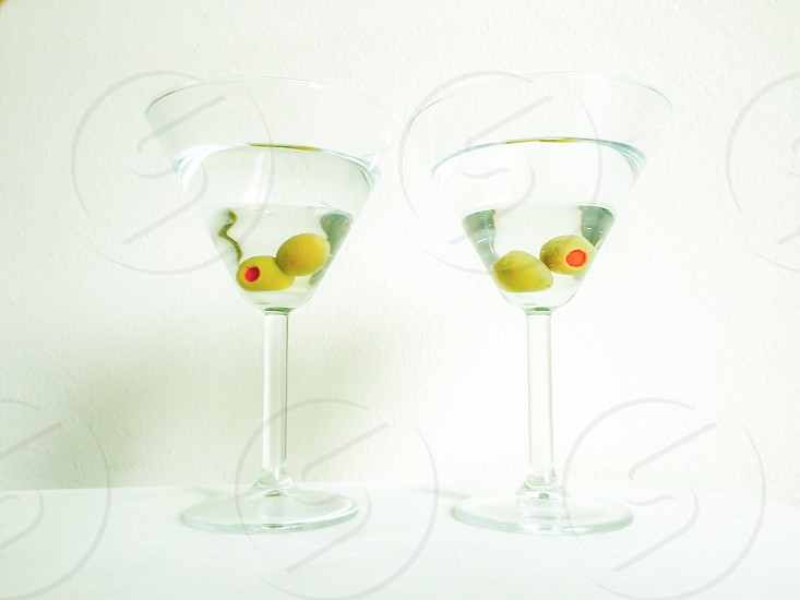 Martini toast. Dirty with olives photo