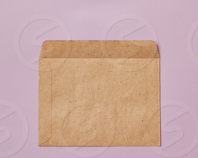 Opened empty craft brown Recycle envelope isolated on pink background as business concept with copy space flat lay photo