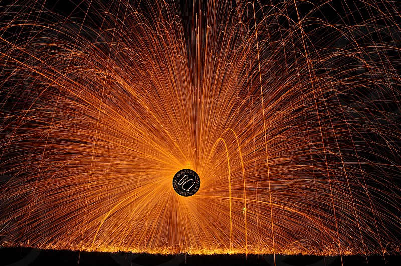 Photo I did of myself spinning burning steel wool mounted in a wisk. I used a cordless drill to spin it extremely fast. You can see my silhouette behind the sparks. photo
