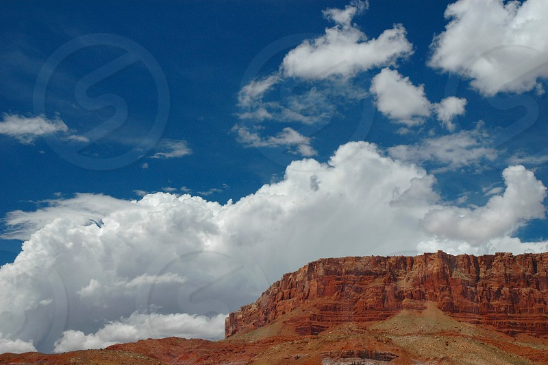 Soft clouds hard rock. North rim of the Grand Canyon area photo