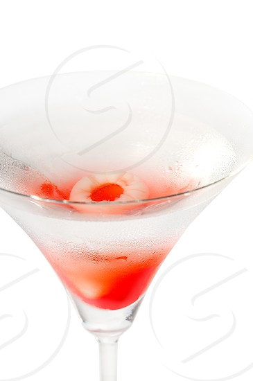 Lychee martini cocktail straight up isolated on white background photo