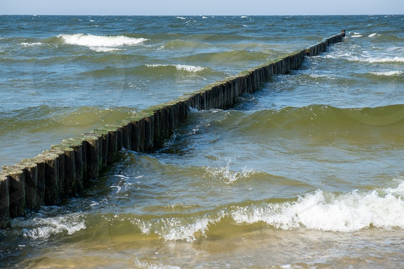 View to the Baltic Sea with its groynes at the beach of Zempin.  photo