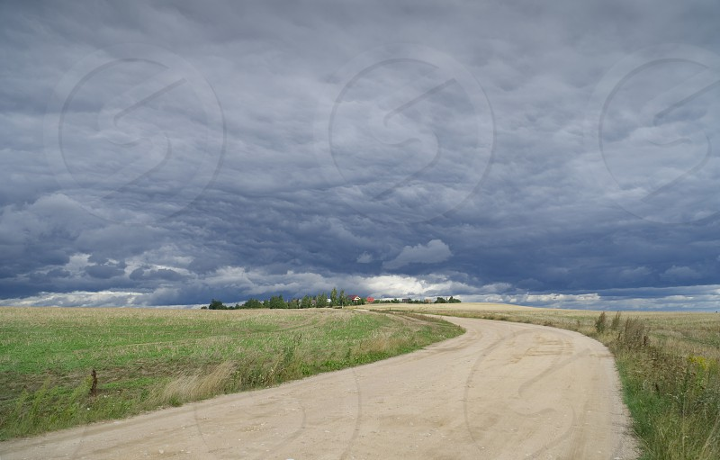 Clouds before the rain in the village in Belarus photo