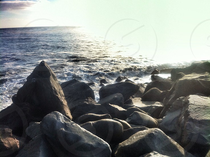 black stones on the sea photo