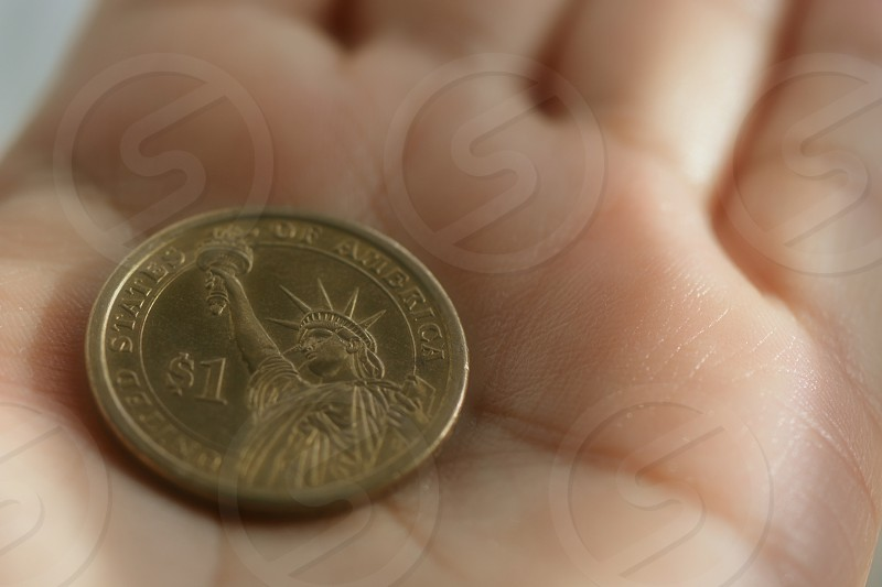 gold liberty designed 1 us dollar coin photo