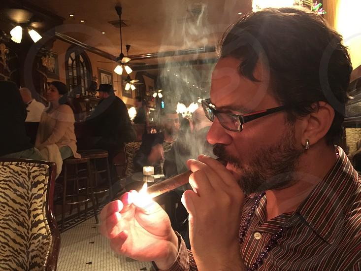 Lighting a cigar photo