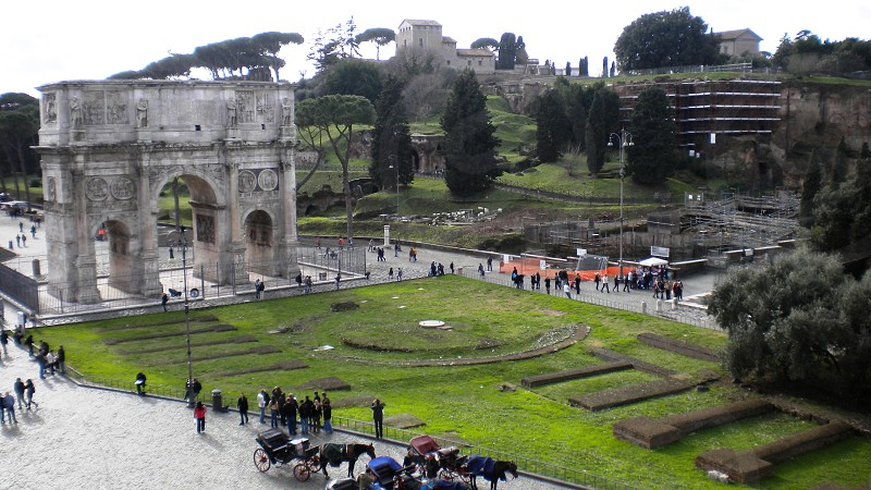 people walking near the arc de triomphe photo