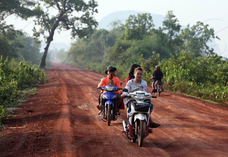 Die Landstrasse 12 beim Dorf Mahaxai Mai von Tham Pa Fa unweit der Stadt Tha Khaek in zentral Laos an der Grenze zu Thailand in Suedostasien. photo
