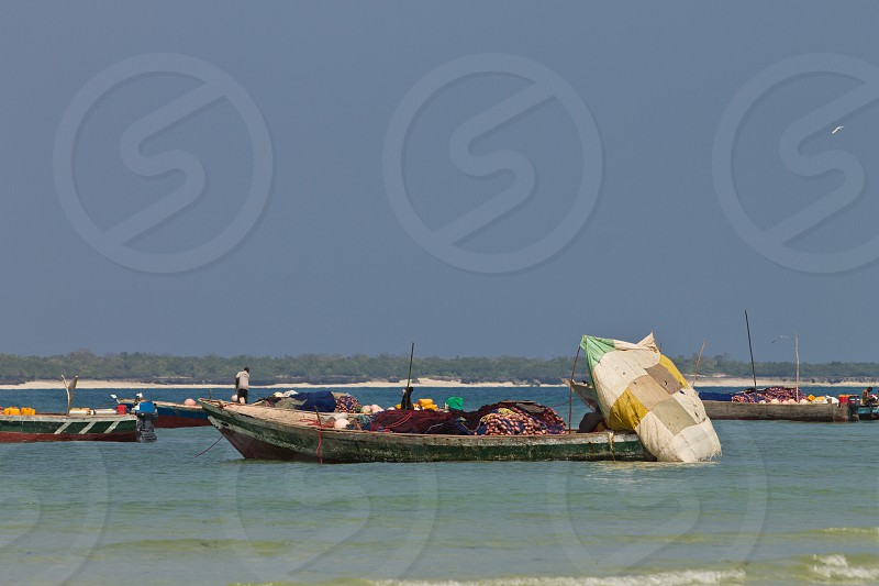 Fishing boats off the coast of Tanzania photo