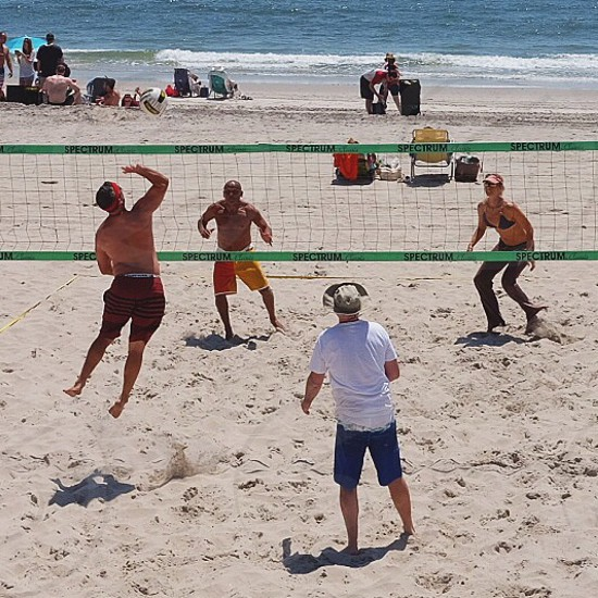 people playing volleyball photo