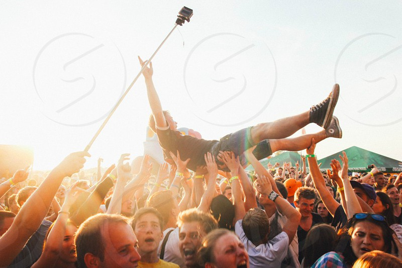 People are carrying man during the festival photo