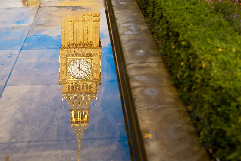 Big Ben Clock Tower puddle water reflection in London England photo