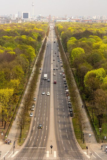High shot of Strasse des 17. Juni leading to Berlin's city skyline in the brackground (in the Grosse Stern (Great Star) Grosser Tiergarten Park Berlin Germany) photo