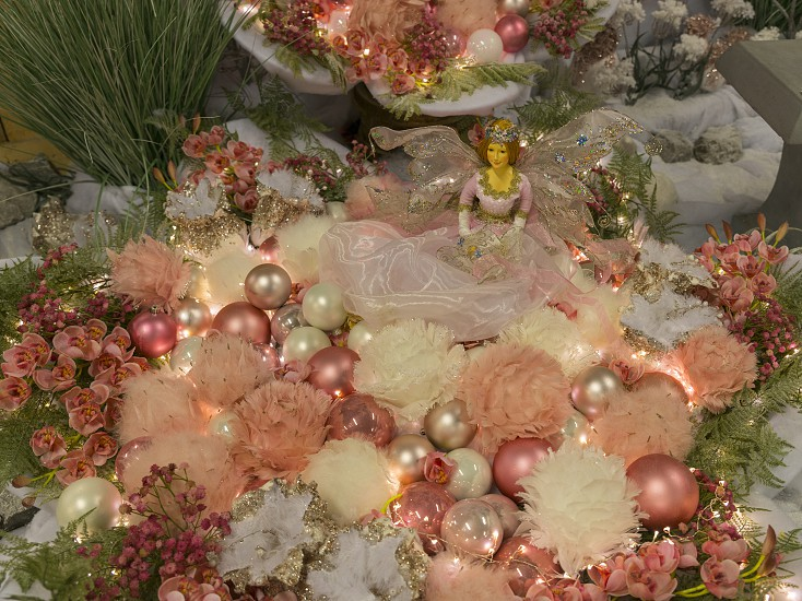 AmsterdamHolland18-oct-2018:beautifull christmas decoration with pink Christmas garland with fairy and floral ornament and christmas balls photo