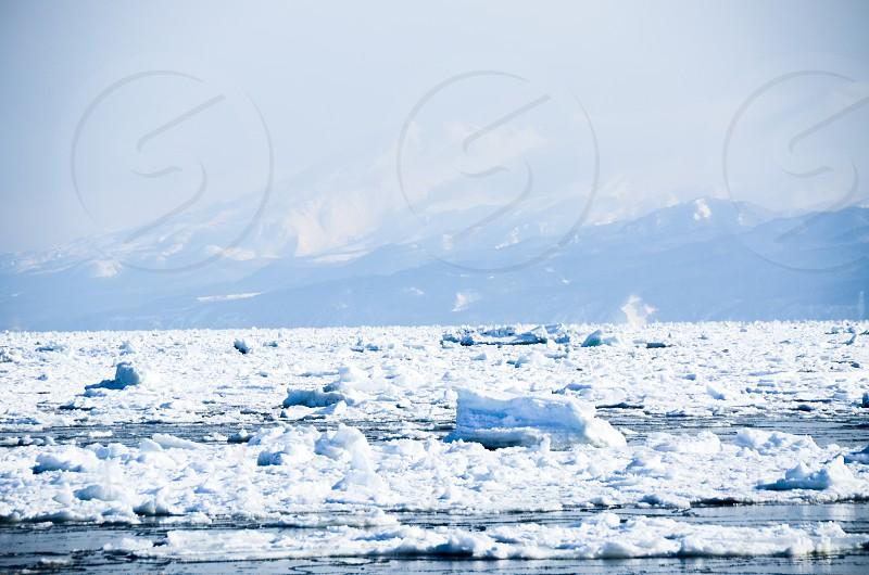 Drift Ice in Sea of Okhotsk and Shiretoko Range Abashiri Hokaido Japan photo