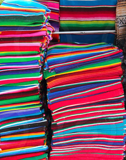 Mexican serape colorful stacked in handcrafts market photo