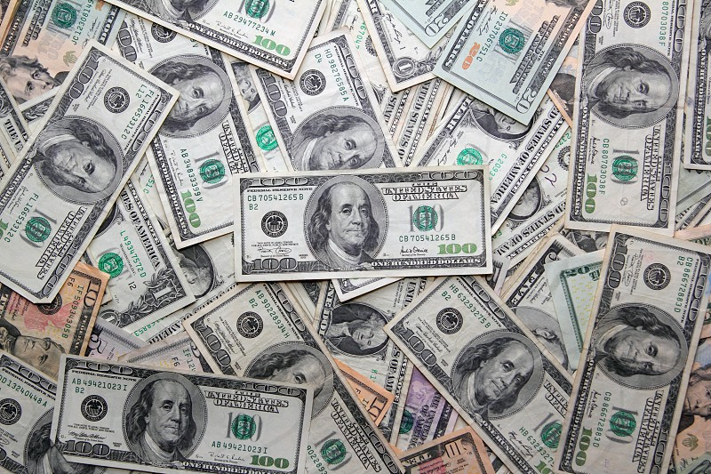 Dollar bank notes many American currency photo