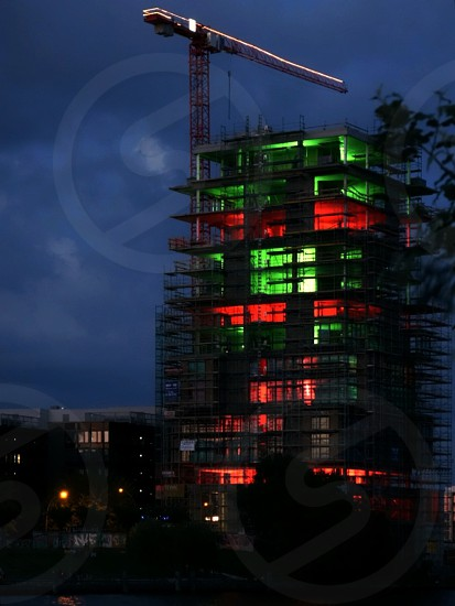 red and green building under construction photo