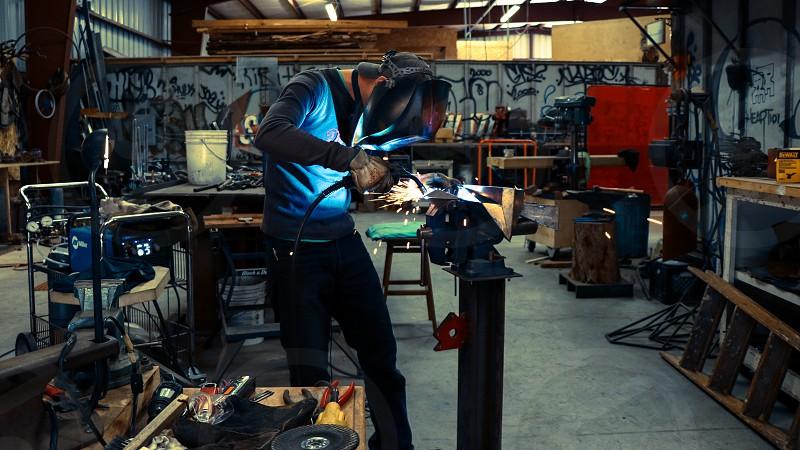 art build melt weld live conquer  photo