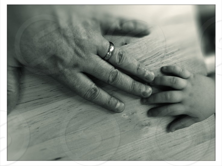 Man and boy hands photo