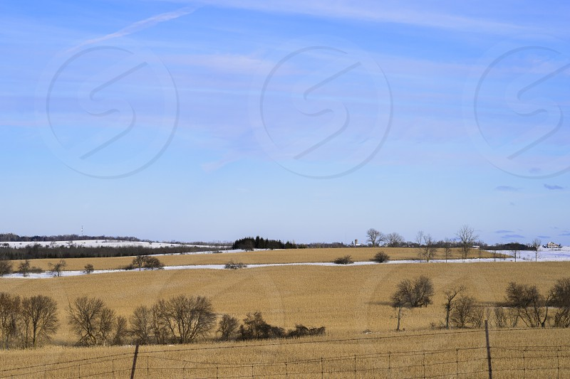 Winter Farm Scene plenty of Acreage with a nice Farm House situated in the mid right of the image. photo