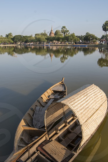 fishingboat at the lake at the Historical Park in Sukhothai in the Provinz Sukhothai in Thailand.   Thailand Sukhothai November 2018 photo