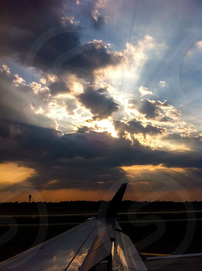 Airplane view sunset runway photo
