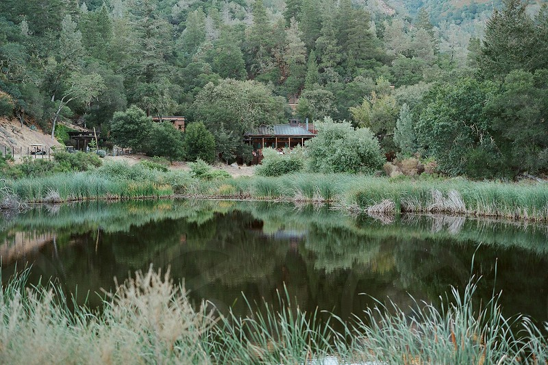 secluded ranch lake cabin mountains photo