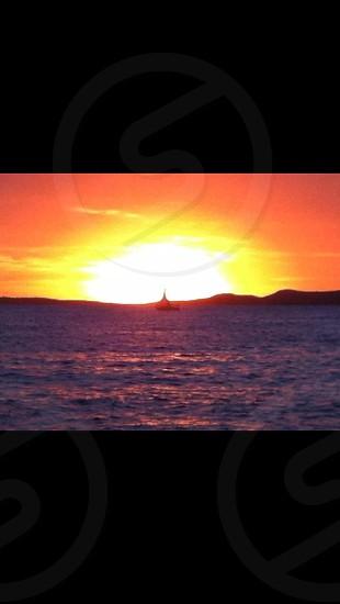Ibiza sunset boat  photo