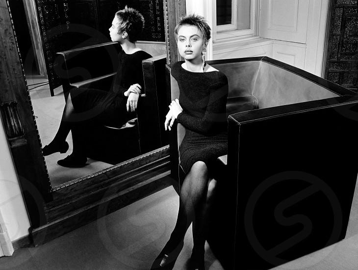 girl in Trussardi chair reflection in miror photo