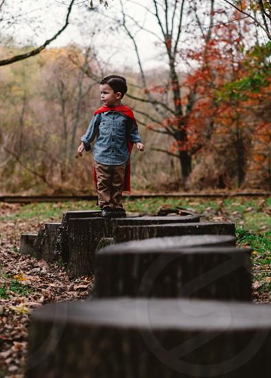 Outdoor Autumn fun with Superman cape photo