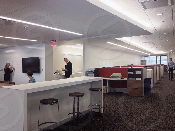 Modern office. Copy area cubicles and informal meeting space photo