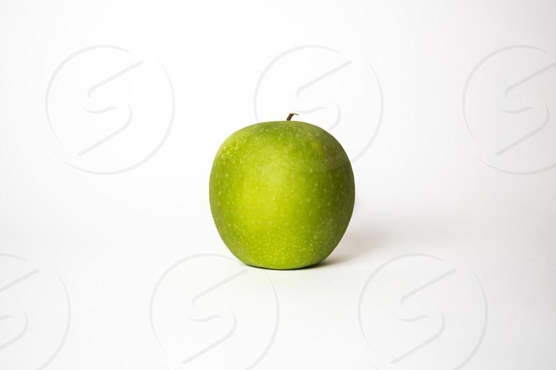 Green apple on white background photo