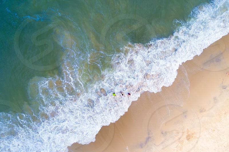 An Aerial scene of kid on the beach photo