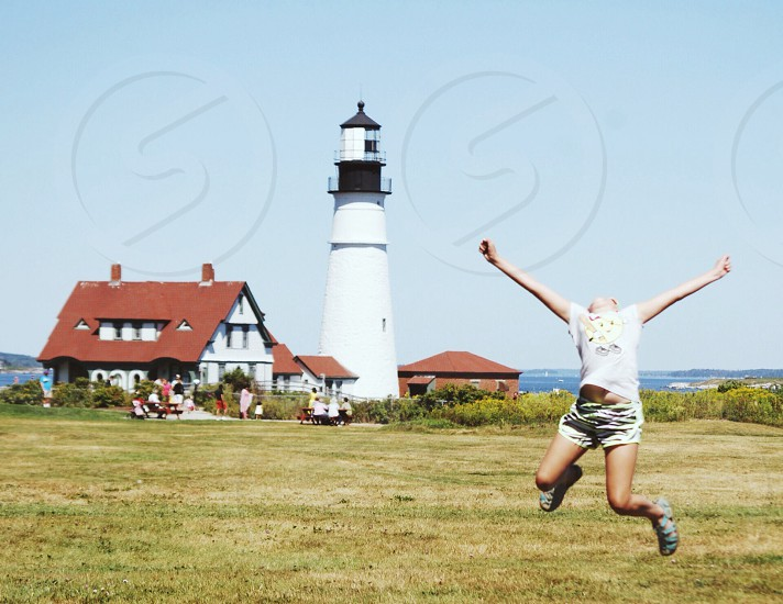 woman near lighthouse photo