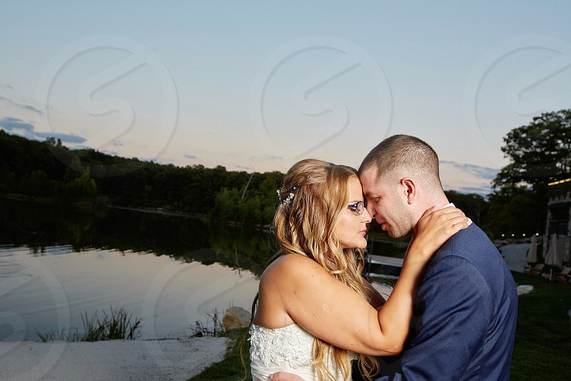 Wedding bride and groom sunset beautiful background couple photo