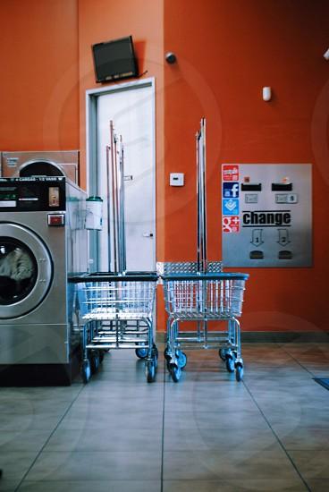 gray carts near silver front load washing machine photo